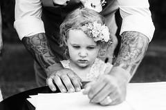 Flower Girl Certifies (Leighton Wallis) Tags: sony alpha a7r mirrorless ilce7r 55mm f18 emount newcastle nsw newsouthwales australia wedding groom sign signature marriagecertificate flowergirl child tattoo sleevetattoos pen