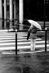 In front of the passage (pascalcolin1) Tags: paris13 femme woman pluie rain neige snow passage passagepiéton crosswalk crossing parapluie umbrella reflets reflection photoderue streetview urbanarte noiretblanc blackandwhite photopascalcolin 50mm canon50mm canon