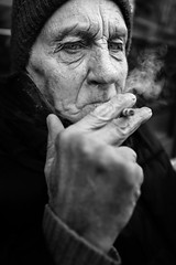 The smoker (Giulio Magnifico) Tags: soulful streetphotography streetlife 28mm thoughts urban cool citylife udine fvg portait smoke street friuli city shadow urbanlife naturallight cigarette italy leicaq bar candid detail ancient blackandwhite curiosity friendly personality leica smoking