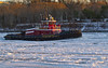 Tug on Ice (brucetopher) Tags: ice canal water sea ocean seaice iceberg flow moving sunset light sunlight tug tugboat boat ship motor winter cold icy wintry season arcticblast arctic northern atlantic