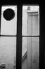 One last look (David Ian Ross) Tags: boulevarddelavillette 19tharrondissement rooftop olympustrip35 camille mathius jamie ilford xp2 400 35mm kitchen paris window apartment monochrome