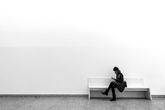 Minimalism (Daniel Nebreda Lucea) Tags: minimal minimalismo minimalism minimalistic minimalistico woman mujer one una lines lineas shapes formas sitting sentada bank banco black white blanco negro monochrome monocromatico light luz shadow sombra contrast contraste urban urbano urbana girl chica people gente inside interior indoor simplicity simple canon 60d 1018mm looking smartphone writing escribiendo relax sit sentar sentarse escribir composicion composition clear limpio