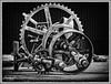 P2201451a(B&W)-EditFAA (john.cote58) Tags: gear wheel system pulley belt rusted corroded steal metal trash bw blackandwhite monochrome interiordesign fineart photography professional josephyvoncote contrast grain