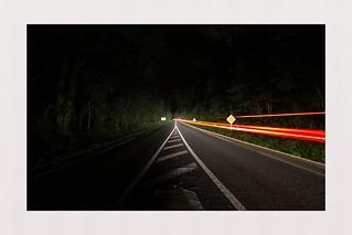 Fleeing car light in the dark - minimalism 3