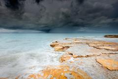 Monsoonal showers (Louise Denton) Tags: monsoon darwin nt australia rocks beach blue cliffs orange water wet season tropical storm weather shower rain moody
