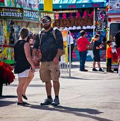 Fair patrons (LarryJay99 ) Tags: westpalmbeach florida southfloridafair canon60d shades glasses sunglasses men male man guy guys dude dudes urbanbackpacker people beard facialhair cargopants blackwhite gondolas hairy hairyface urban candid unsuspecting color backpack backpacker