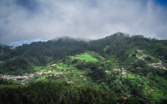 Living on a mountain (RIch-ART In PIXELS) Tags: machico madeira hills sky clouds tree trees grass grassland village house hillside mountains mountainside canon green portugal