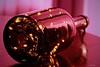 "macro ""The wine festival"" (kiareimages1) Tags: bottle bright garland wine light reflection rossomagenta macro macrophotographie macrophoto imagery kiareimaginations"