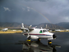 after the rain (Jaws300) Tags: unitedstates usa united states america utah ut rainbow rain rainy wet reflection tip tiptank tank high wing highwing turboprop propeller rocket rice ricerocket transport check american tpe331 garrett twin mitsubishi flightline act mu2 mu2b mu2b36 n361ja rocky mountain gorgeous scenery freight freighter cargo ramp apron stand parking parked storm stormy weather wx converted conversion cargodoor logancache airport logancacheairport lgu klgu ups dhl