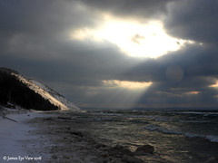 Winter Rays (JamesEyeViewPhotography) Tags: beach sunset lake michigan water waves winter greatlakes sky clouds snow ice sleepingbeardunes nationallakeshore landscape lakemichigan northernmichigan nature january trees sand dunes jameseyeviewphotography