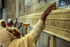 To touch the place where Jesus was crucified (ybiberman) Tags: israel jerusalem oldcity alquds christianquarter churchoftheholysepulchre pilgrims ethiopian women old cane mosaic excited veil portrait candid streetphotography