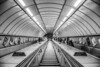 Tube in the tube (Paul Wrights Reserved) Tags: tube leadinglines underground station stars escalator lights london loines curved advertisment vanishingpoint people metro blackandwhite city citylife pointofview pov railings metal building architecture