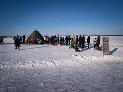 P1000897 (vargandras) Tags: frozen lake snow people line queue sign ice blue sky tent siilinkari näsijärvi tampere suomi finland
