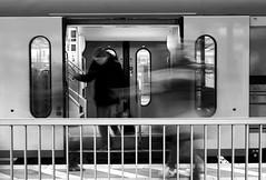 In And Out (Isengardt) Tags: in out rein raus departing entfernen zug train doors türen schiebetüren geländer rail person mann man mensch aussteigen einsteigen abfahrt departure ankunft arrival blurr blurry unschärfe bewegungsunschärfe motion motionblur bewegung verkehr traffic verkehrsmittel bahnsteig gleis olympus omd em1 1250mm esslingen badenwürttemberg deutschland germany europe europa street strase