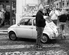 500 (halifaxlight (back in April)) Tags: italy lazio rome fiat500 cinqucento car auto street pedestrians shop crossing cobblestones bw
