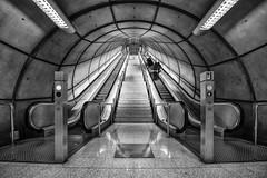 Fosterito (Leipzig_trifft_Wien) Tags: foster underground metro bilbao station escalator perspective concrete black white monochrome architecture depth grey bw entrance subway light contrast composition vanishing