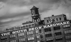 SMITH BROS' (tim.perdue) Tags: smith bros hardware building sign architecture rooftop water tank brothers black white monochrome columbus ohio downtown urban city old warehouse factory historic restoration renovation sky clouds angle bw
