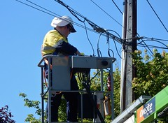 Fixing the Wires (mikecogh) Tags: worker linesman helmet hiviz whs wires cables stobiepole job telegraphpole cherrypicker snorkel hilton