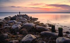 The fisherman (Stefan Sellmer) Tags: longexposure colorful sunrise winter rocks balticcoast color cloude colors seascape lowtide balticsea sunday seaside strande schleswigholstein deutschland de