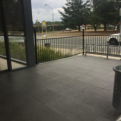 Bicycle racks outside supermarket, Queanbeyan (sustainablejill) Tags: bicycle racks stands pavement supermarket bike infrastructure active paving building metal queanbeyan aldi