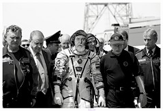 That Distressing Moment When You're Led Away From the Spacecraft (Studio d'Xavier) Tags: werehere whilerunningpics cosmonaut astronaut spacecraft space xavierpomahehko bw 35482