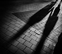 Hand in Hand (Dan-Schneider) Tags: streetphotography street silhouette shadow schwarzweiss schneider blackandwhite bw fuji fujix monochrome moment minimalism