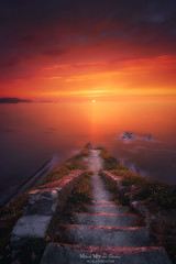 Stairs to nowhere (Mimadeo) Tags: stairs down death water sea coast seascape ocean exposure long outdoor longexposure calm nobody peaceful staircase stair getxo basquecountry paisvasco euskadi stone lagalea landscape dramatic red sky clouds