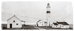 Point Amour Lighthouse - Tallest lighthouse in Atlantic Canada (Brett of Binnshire) Tags: historicbuilding building water weather clouds labrador lanseamour tower ocean lighthouse scenic locationrecorded house shoreline architecture canada manipulations rain 2391 shed