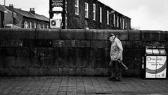 2018_017 (Chilanga Cement) Tags: fuji fujix100f xseries x100f x100s x bw blackandwhite bricks street streetphotography sidewalk shadows shopping man wall pavement