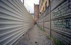 Wrocław, Poland. (wojszyca) Tags: contax g2 zeiss biogon 21mm kodak vision3 50d c41 city urban geometry lines perspective fence wall
