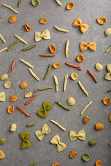 Pasta food pattern (whitesweetcherry) Tags: pasta food banner background italian view top group table raw cooking healthy uncooked types diet textured nutrition ingredient objects above space different dry color yellow concrete loft gray mix concept