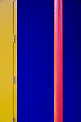 CMY 'kay (James_D_Images) Tags: primary colours yellow cyan magenta blue red door hinges wall pipe post vertical abstract granvilleisland vancouver britishcolumbia