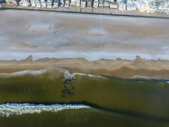 Waves from the Atlantic Ocean hit a snow-covered Manasquan Beach. Captured by a DJI Phantom 4 drone. (apardavila) Tags: atlanticocean djiphantom4 fb jerseyshore manasquan manasquanbeach aerial beach beachfronthomes drone morning rocks sky snow waves