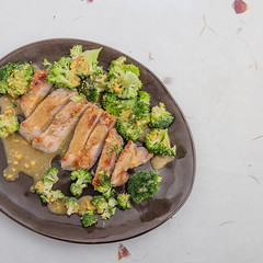 Served grilled pork with broccoli and marinade. (annick vanderschelden) Tags: pork meat grilled sliced broccoli chops oliveoil warm readytoeat served plate pottery marinade honey ginger redwinevinegar mustard