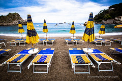 a short story about crowded beach (ignacy50.pl) Tags: beach water sun sky sea seacoast seaside seascape seashore afterseaon sicily italy furniture umbrella travel