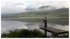 On the other side of the lens. (Louis and Marie Helberg) Tags: landscape drakensberg water nature photographer clouds mountains reflections lake sky grass people