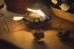 Oil Lamp (Notquiteahuman1) Tags: oillamp esslingen market christmasmarket woodensurface stilllife nikkor50mmf18afd flame fire whinebottles forsale nikond610 night dark noite lâmpadadeóleo tabletop table