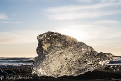 Winter sun through glacier ice (rjonsen) Tags: ice black beach basalt winter sun light holiday iceland horizon