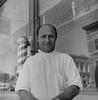 Des Moines Register Collection0593.jpg (The Digital Shoebox) Tags: man monochrome desmoinesregister negative blackandwhite outside kodak scan ebay epsonv700 barber iowa 35mm original film barbershop
