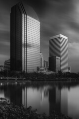Interconnectedness (blondmao) Tags: building asia monochrome reflection blackandwhite fineart cityscape lake noperson sukhumvit bw bnw longexposure skyscraper bangkok benjakitipark dark water ratchadalake architecture park sky skyline 13stopper thailand