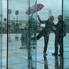 Dansons sous la pluie.... (jjcordier) Tags: pluie transparence danse ladéfense grandearche paris couple sundaylights winter