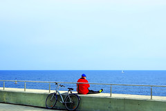 Between vehicles  ♪♫ (Fnikos) Tags: sea seascape sky skyline blue red boat sailboat wall people bicycle bike vehicle outdoor