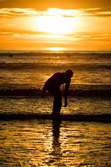 Preparation (GavinZ) Tags: california sandiego surfing tourmaline beach pacificbeach silhouette surfer surf waves ocean water sun sunset