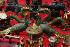 Antique Myth Creature Duel (Jason Witwicker) Tags: macro macrophotography antique stall fleamarket hanoi vietnam easternstyle phoenix dragon bronze antiquepistol buffalo decoration decorative asia street streetphotography mascot