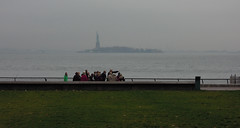 A gaggle of people who chances are have never been to Manhattan before. The Statue of Liberty and New York Harbor in the background on a gray autumn day. The view from the very southern end of Battery Park City. Oct 2016. (wavz13) Tags: newyorkphotographs newyorkphotos urbanphotography urbanphotos urbanscenes cityphotography cityphotos newyorkphotography manhattanphotography urbanlife newyorklife manhattanlife lowermanhattan lowerwestside city rainy dreary tourists newyorktourists manhattantourists