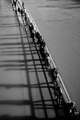 Five feet high and rising (AdriaanVdM) Tags: bw water flood seine paris shadows walking shadow street streetphotography fujix skopar monotone gray flooding river city quai