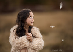 Soft (Portraits by Suzy) Tags: winter nature gold golden child soft long hair childhood sweater las vegas feathers scarf natural light coat portrait fur knit hat boho warm clothing portraits by suzy mead