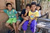 Friends at the sari sari shop, Iloilo province, Philippines (Yekkes) Tags: travel asia philippines iloilo sarisaristore children kids shy posing friends happiness visayas