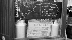 sweet dreams are made of cheese (byronv2) Tags: stockbridge edinburgh edimbourg scotland blackandwhite blackwhite bw monochrome ijmellis cheese fromage cheesemonger sign funny window shop dairy cheeseshop speechbubble thoughtbubble
