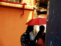 ... a red umbrella ... (@ Images and Pictures) Tags: umbrellas redumbrella photography streetphotography kolkata streetincolour buildings